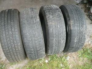 Four 215-65-16  snow tires  $120.00