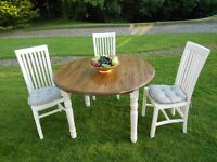 Beautiful Table And 3 Chairs With Cushions