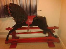 Haddon black full size rocking horse on a pillar stand