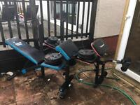 2 exercise benches with weights