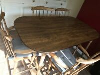 Dark wooden dining table & 4 chairs