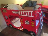 'Cool' fire engine novelty bunk bed with step ladder with free shelving unit! Kids just love it!