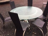 Large round frosted volcanic glass top dining table & six high back chairs