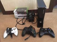 Xbox 360 Elite (250GB) with 3 controllers and 8 games
