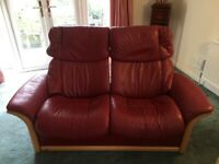 Stressless 2 seater red leather, manual reclining sofa.