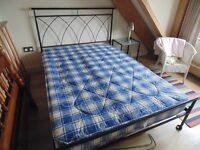Double bed 4ft 6in Black wrought iron with mattress and matching bed side tables.