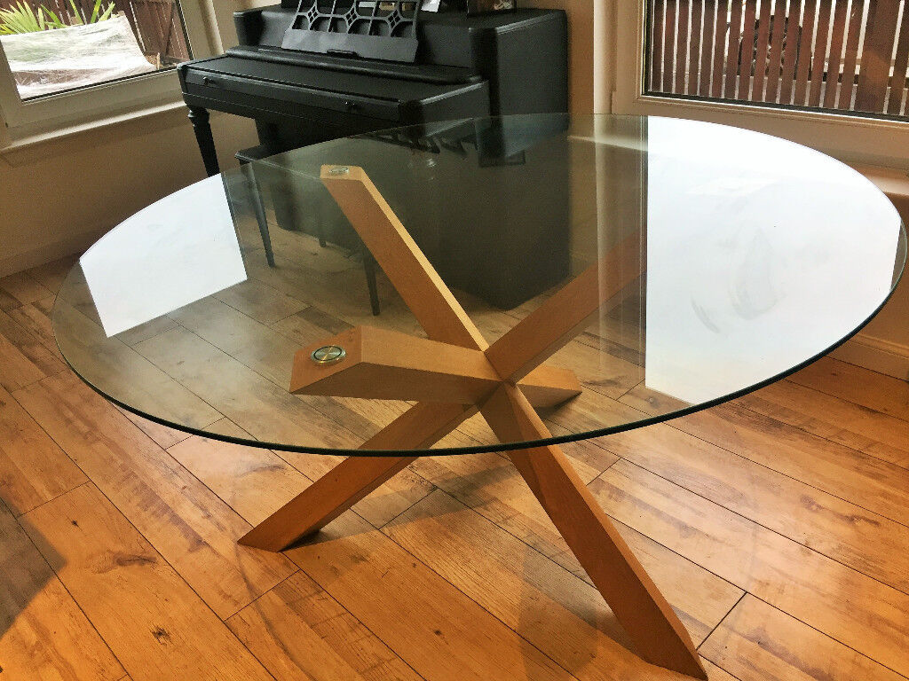 Round Glass Topped Dining Table With Wooden Puzzle Legs 150 Cm