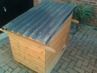 chicken coop including feed bin and water bowl