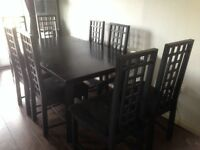 Dining table extending with 8 chairs black