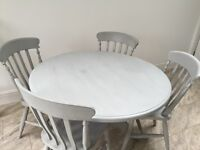 Painted pine kitchen table and four chairs