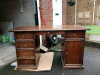 Solid desk with draws