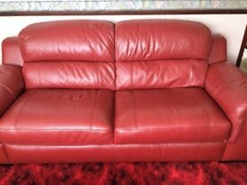 A 3 SEATER RED LEATHER SOFA