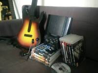 PS3 UltraSlim with Guitar Hero / Rock Band and 11 PlayStation 3 games