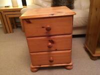 Pine bedside drawers.