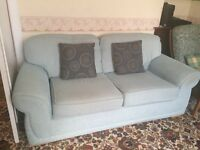 Pale blue 2 seater sofa with 2 scatter cushions. Smoke & Pet free home.