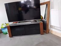 Tv unit for sale. Glass top and doors with wood finish on sides. Suitable for up to 60 inch tvs