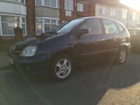 Nissan Almera tino 12 months mot reverse camera hpi clear drives superb low millege