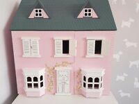 Beautiful pink wooden dolls house with furniture