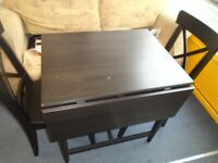 IKEA FOLDING BLACK DINING TABLE AND 2 CHAIRS at Haven Trust's charity shop
