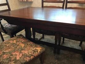 Old charm solid oak table with six chairs. Immaculate condition.