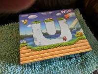 Boxed Wii U console (32gb Deluxe model) + digital games