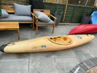 Pyranha kayak and paddle, perfect for small adult or teenager.