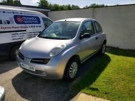 Nissan micra silver car. Great first car.