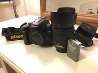 Nikon D5000 with 55-200mm lens+UV filter, plus spare battery (no manual)