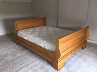 King-size oak Barker & Stonehouse sleigh bed with SilentNight king-size mattress (hardly used).