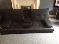 Brown faux leather sofa.
