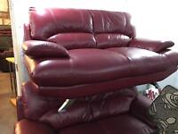 2 as new red leather 2 seater sofas
