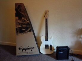 NEW ELECTRIC GUITAR + AMPLIFIER