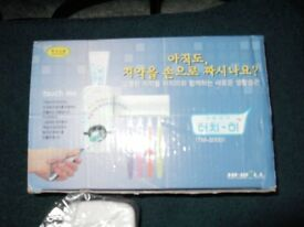 Toothpaste Dispenser with Toothbrush Holder Brand New
