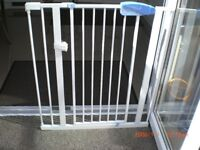 Lindam stair gate with battery operated alarm.