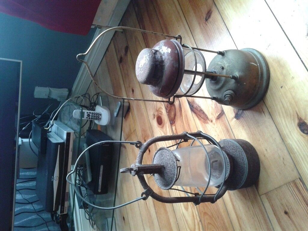Two old oil lamps any interest out there