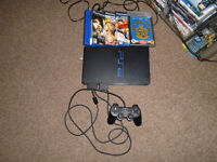 Playstation 2. 2 memory cards. 6 games. One controller. Working and boxed £30