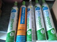 5 Sodastream canisters (4 sealed, 1 unsealed but almost full)