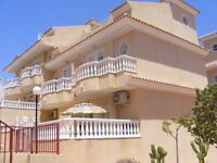 A beautifully furnished and very well equipped two storey townhouse in Villamartin Spain