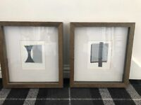 Grey pictures with wooden frames