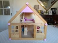 Wooden Dolls House with furniture and two dolls.