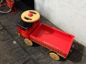 Childs large wooden ride on fire truck