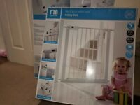 Two Mothercare easy loc safety gates