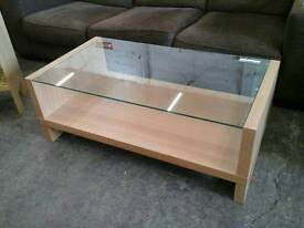 Modern glass topped coffee table with storage
