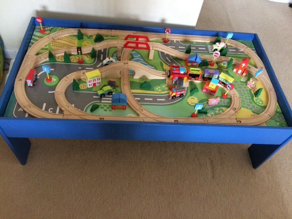 Large train table, track and trains with village