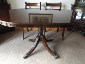 Mahogany dining table and 4 chairs. Middle setion of table can be removed to make smaller.