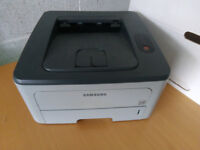 Samsung laser printer, HP colour laser jet, chest of drawers and a spinning office chair