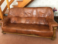 Three piece traditional tan leather suite.