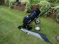 Full set of as new Fazer Contender golf clubs inc bag and trolley