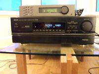 Denon AVC 2800 surround sound amplifier with remote control.