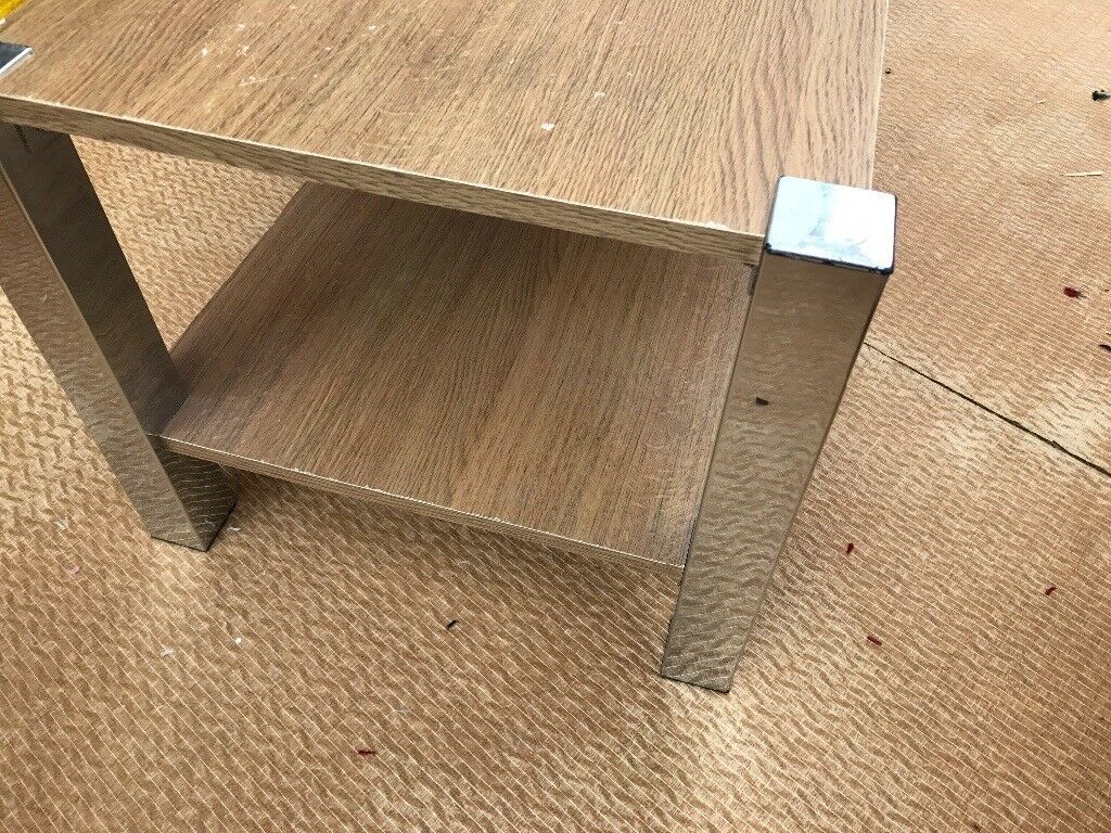 BROWN OAK LIKE WOODEN TABLE WITH SILVER HARDWARE